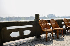 Riverside chairs on sunny spring day Royalty Free Stock Photography