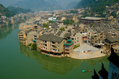 Riverside Chinese town. Looking down on the river and rooftops of residential buildings in Zhenyuan, an ancient town in Guizhou, China Royalty Free Stock Photography