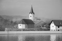 Riverside Church. A black & white image of village church by a river Royalty Free Stock Image