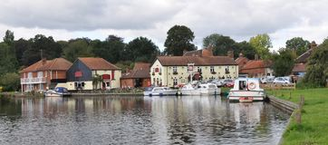 Riverside at Coltishall, Norfolk Broads, UK with boats and local inn Royalty Free Stock Photography