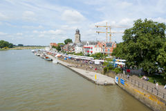 Riverside crowded with people along the line of book stalls Royalty Free Stock Photo