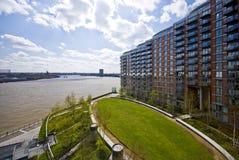 Riverside development. Modern riverside development with landscaped communal garden stock photos