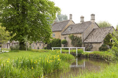 Riverside English village homes in summer picturesque setting Stock Image