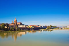 Riverside at Florene. Riverside panorama with some houses and a church at Florene Royalty Free Stock Image