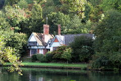 Riverside House. Idyllic House on the Banks of a River in England Royalty Free Stock Image