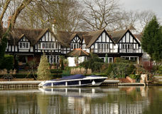 Riverside House. Winter scene of a Luxurious Timber Framed House on the banks of a River in England Royalty Free Stock Image
