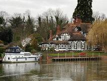 Riverside House. Winter scene of a Luxurious Timber Framed House on the banks of a River in England Stock Image