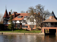 Riverside House. Winter scene of a Luxurious Riverside residence and Boathouse in England Royalty Free Stock Photography