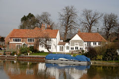 Riverside House. House with Boat Moorings on the banks of a River in England Stock Images