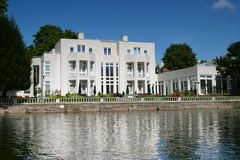 Riverside house. A large, modern house on the riverside Stock Photo