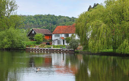 Riverside house and garden on the River Thames in England Stock Photography