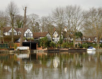 Riverside Houses. Winter scene of  Luxurious Timber Framed Houses on the banks of a River in England Royalty Free Stock Images