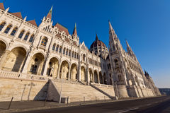 Riverside of the hungarian Parliament in Budapest. Riverside view of the famous hungarian Parliament building in Budapest, from an attractive angle Royalty Free Stock Photo