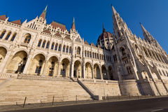 Riverside of the hungarian Parliament in Budapest. Riverside view of the famous hungarian Parliament building in Budapest, from an attractive angle Stock Photos
