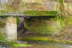 A riverside image of Hisley Bridge an old packhorse bridge over the river stock photo