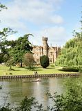 Riverside Mansion. Gothic Riverside House on the Banks of the River Thames a canoeist passing by Stock Images