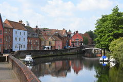 Riverside near Fye Bridge, River Wensum, Norwich, England. The riverside with its old houses near Fye Bridge over the River Wensum in Norwich, England royalty free stock photo
