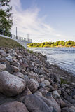 Riverside. Nice riverside. Lots of colorful stones Stock Image