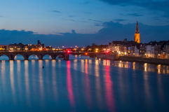Riverside by night in Maastricht, The Netherlands. View on the Maas river by night in Maastricht, The Netherlands Royalty Free Stock Photography