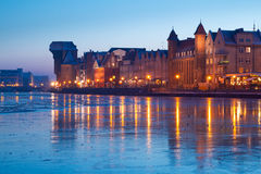 Riverside of old town in Gdansk at dusk. Old town in Gdansk with frozen Motlawa river at dusk, Poland Stock Images