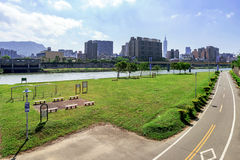 Riverside park cycling path Stock Images