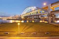 Riverside park and the famous Rainbow Bridge over Keelung River Royalty Free Stock Photos