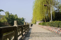 Riverside paved footway with stone balustrades in sunny spring Stock Photos