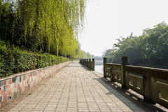 Riverside pavement with stone balustrades in sunny spring Stock Images