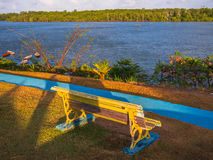 Riverside plaza. Riverside park bench - Amazon River - Brazil Stock Photo