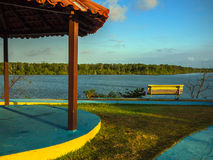 Riverside plaza. Riverside park bench - Amazon River - Brazil Stock Image