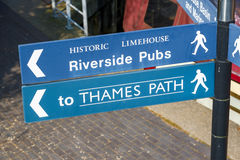 Riverside Pubs and Thames Path street sign Royalty Free Stock Image