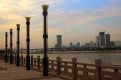 The riverside scenery. The riverside、The rivers、And the consideration of、 buildings、The sky Stock Photos