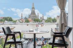 Riverside seats and tables near Chaophraya river in Bangkok, Tha Stock Photo