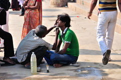 Riverside Shaving in Varanasi Stock Photos