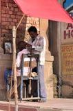 Riverside Shaving in Varanasi Stock Image