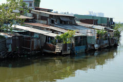 Riverside slum, houses near polluted river Royalty Free Stock Photography