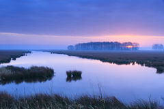 Riverside sunrise Stock Photos