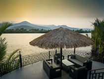 Riverside sunset view in kampot cambodia asia with deck sofas Stock Photography