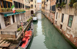 Riverside of Venice. With boats and Gondola Stock Photography