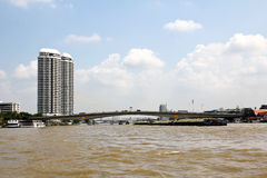 Riverside view. Bridge over River, Bangkok. Royalty Free Stock Photos
