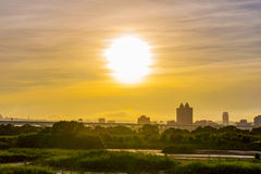 Riverside view of sunset with city buildings Royalty Free Stock Images