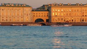 Riverside view of Winter Palace,Winter groove, sundown time. Saint-Petersburg. Russia, Saint-Petersburg, 2 JULY 2016: pleasure water transport on Neva river stock video footage