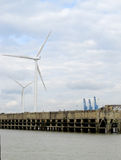 Riverside Wind turbines royalty free stock photography
