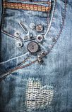 Riverts on jeans Stock Photography