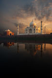Riverview Taj Mahal & Jawab at Sunset. The iconic Taj Mahal and sunset sky beautifully reflected in the calmly flowing Jamuna river Royalty Free Stock Image