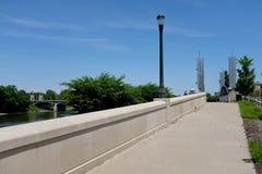 Riverwalk Pedestrian Bridge Over Dike Floodgate Royalty Free Stock Photos