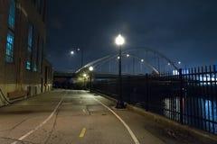 Free Riverwalk Promenade And City Bridge At Night. Stock Images - 105184344