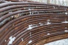 Rivesta di ferro i montaggi, rimuova l'arco nella pila Fotografie Stock