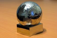 Rivesta di ferro il puzzle del globo Immagini Stock