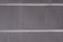 Rivesta di ferro il rivestimento del piatto della lamina di metallo con i fori perforati in un modello geometrico ed in un effett Immagini Stock